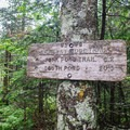 A sign just past the summit pointing the way along the ridge.- Mount Starr King + Mount Waumbek