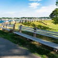Park benches line the paths.- Fort Sewall