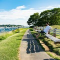 Waterfront paths at Fort Sewall feature benches in abundance.- Fort Sewall