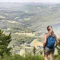 Overlooking patches of farmland and fields far below.- Bearpen Mountain