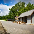 You'll find restrooms, a cold beer with YeeHaw Brewing, and stand-up paddleboard and canoe rentals with River Sports next to the parking lot at Mead's Quarry. - Mead's Quarry at Ijams