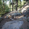 This rock is where you depart the Pipeline Trail and head up the slabs.- Mount Elden Slabs