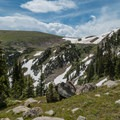 Snow can persist in the shade through late July.- Devils Thumb + Kings Lake Loop
