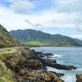 Makua Beach is nestled at the base of the Waianae Mountains.- Makua Beach