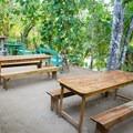 Picnic tables near the swimming area.- Mopan River: Clarissa Falls