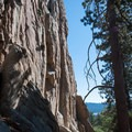 The dramatic south face of Castle Rock, home to many of the crag's classic climbs.- Castle Rock Crag via Lower Trailhead