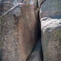 This tight squeeze provides the safest scramble to the summit of Castle Rock, which hosts big views and a couple of top-rope bolt anchors.- Castle Rock Crag via Lower Trailhead