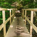 A bridge crosses the brook as you get closer to the falls.- Arethusa Falls