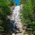 A person provides scale at this tall waterfall.- Arethusa Falls