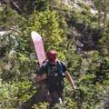 Navigating the vegetation en route.- Dead Elk Couloir