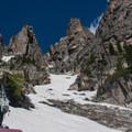 Jagged peaks and spring snow.- Dead Elk Couloir