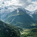 Sun beams breaking the clouds above Tre le Champ.- Tour Du Mont Blanc: Stages 9, 10 + 11