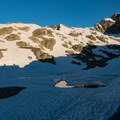 Lac Blanc still frozen in early July.- Tour Du Mont Blanc: Stages 9, 10 + 11