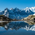 Reflection in an alpine lake opposite Mont Blanc.- Tour Du Mont Blanc: Stages 9, 10 + 11