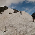 The snowy ridgeline from the col may require spikes in July.- Tour Du Mont Blanc: Stages 9, 10 + 11