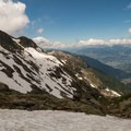 Steep snow slopes yield to views of previously unseen valleys.- Tour Du Mont Blanc: Stages 9, 10 + 11