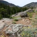 The trail traverses several rocky sections as it climbs toward the lake.- Lake Louise Trail