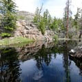 A beautiful reflecting pond along the trail.- Lake Louise Trail