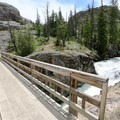 A short diversion down the Glacier Trail takes hikers to a bridge over the thunderous Torrey Creek.- Lake Louise Trail
