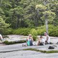 Enjoying lunch on the rock beach.- Minnewaska State Park Preserve