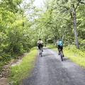 Bikers along Upper Awosting Carriage Road.- Minnewaska State Park Preserve