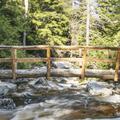 A bridge crossing over Fly Brook.- Minnewaska State Park Preserve