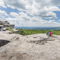 Examining the conglomerate makeup of the cliffs.- Minnewaska State Park Preserve