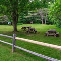 Picnic tables can be found on both sides of U.S.-4.- Quechee State Park