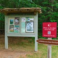 A trail leading to a nearby nature center starts from the picnic area.- Quechee State Park