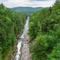 The view looking south from the bridge.- Quechee State Park