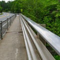 The bridge has a pedestrian lane on each side, allowing for views into the gorge.- Quechee State Park