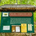 The trailhead kiosk at the large parking area. - Red Hill Fire Tower via Red Hill + Cabin Trails