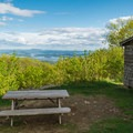 A picnic table provides a seat with a view.- Red Hill Fire Tower via Red Hill + Cabin Trails