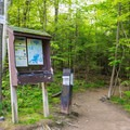 The sign at the trailhead and a donation box.- West Rattlesnake Mountain