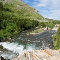 The water drops from Swiftcurrent Lake into a gorge before reaching Lake Sherburne.- Swiftcurrent River Falls