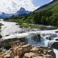 The first series of drops from the lake.- Swiftcurrent River Falls