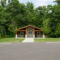 Each picnic area has its own restroom building and large parking area.- Lake Taghkanic State Park