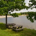 Lakeside picnic tables are also available.- Lake Taghkanic State Park