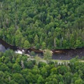 The falls and surrounding area as seen from a small airplane.- Monument Falls