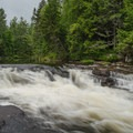 Another view of the falls. Farther back, you can see fishermen looking for the catch of the day.- Monument Falls