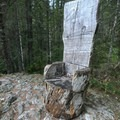 Log chair atop a high rock.- Jawbone Flats