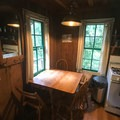 Cabin 1 dining area with ample natural light.- Jawbone Flats