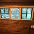 Panoramic window looking out into the forest in the restroom of Cabin 1.- Jawbone Flats