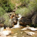 Gold Bug Hot Springs with a warm pool and a cold waterfall inlet.- Gold Bug Hot Springs