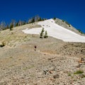The last stretch scrambles over scree and the occasional snowfield.- Avalanche Peak