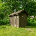 Vault toilets provided at the picnic area.- Zealand Campground and Picnic Area