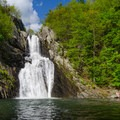High Falls, the 150-foot hidden gem. Swimmers are seen sunbathing next to the falls.- High Falls Conservation Area