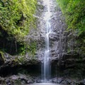 The first falls feature a small pool.- Ka'au Crater Hike