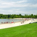 Large grassy areas make the perfect spot for sunbathers while others cool off in the lake.- Lake Taghkanic State Park