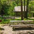There are several picnic tables to enjoy lunch before or after a hike.- Cardigan Mountain State Park